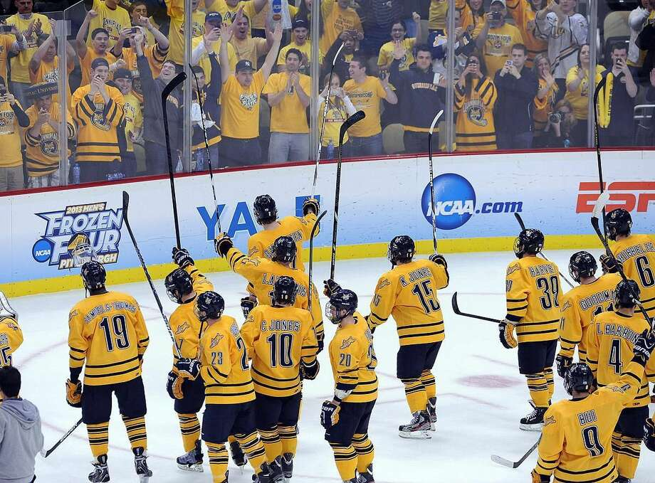 Pittsburg, PA— The Quinnipiac team waves to their fans after they beat St. Cloud 4-1 to advance to the National Championship game against Yale. Photo-Peter Casolino/Register pcasolino@newhavenregister.com