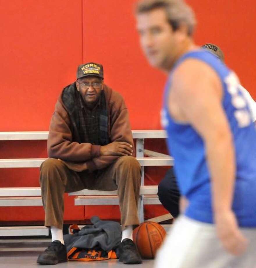 North Haven's Bill Yopp watches his team from the bleachers. Mara Lavitt/New Haven Register