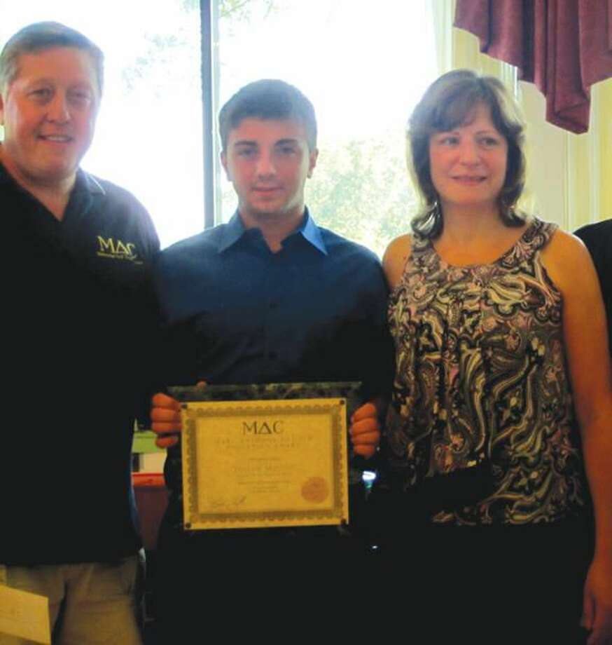 Submitted Photo Joseph Milone, center, was presented a 2012 Italian Youth Foundation education award.