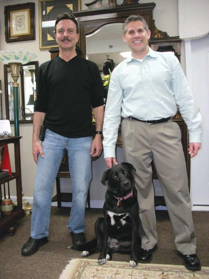 By Lynn Fredricksen Frank Anastasio (left) and Michael Onofrio (right) take great pride in their business, Antiques on Whitney, 2285 Whitney Avenue in Hamden. Their focus is on fine furniture, linens, decorative accessories and estate liquidation services. Pictured with them is shop dog, Breezy, who Anastasio rescued. She earns her keep by warmly welcoming customers.