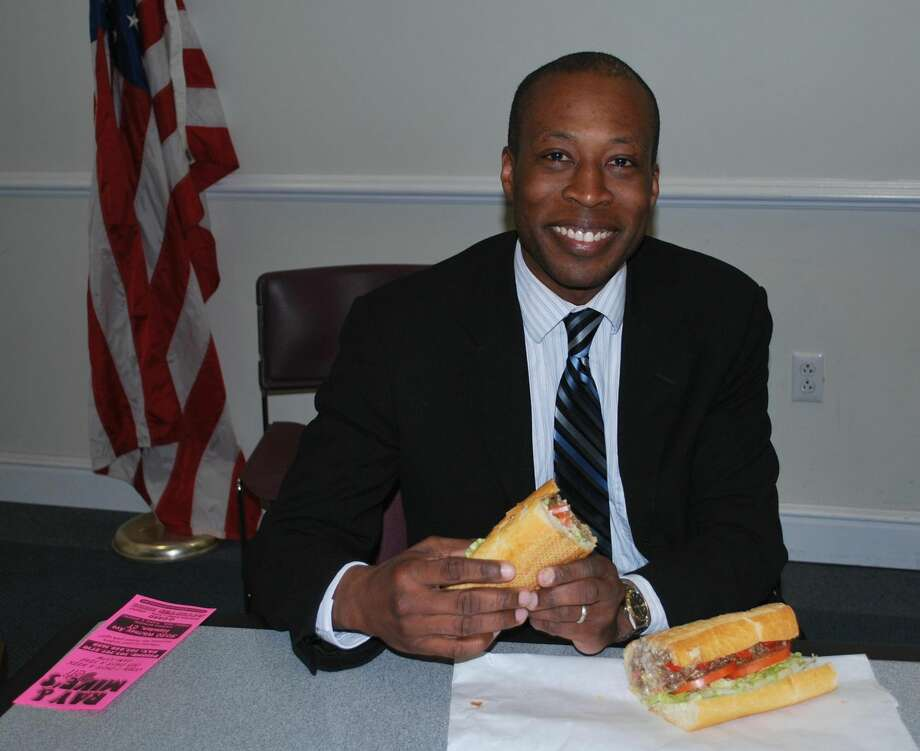 Submitted Photo Mayor Scott Jackson enjoys the very first Ray and Mike's Green Dragon Sandwich.
