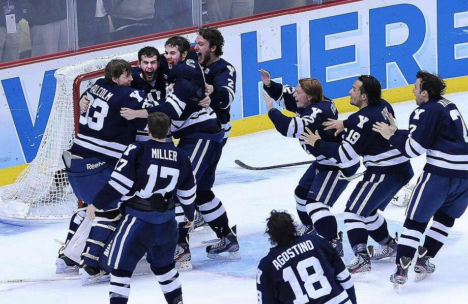 Pittsburg, PA— Yale celebrates their win over Quinnipiac for the NCAA Hockey National Championship. Photo-Peter Casolino/Register pcasolino@newhavenregister.com
