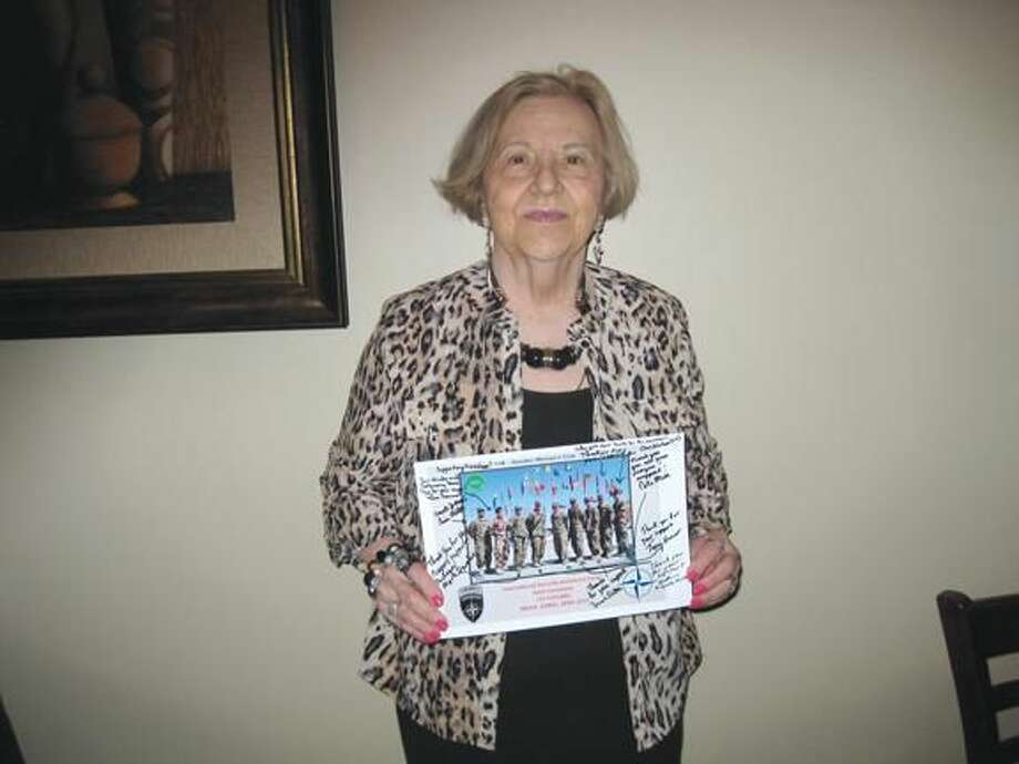 Rosalie Loewenbaum with thank you letter and photo from troops.