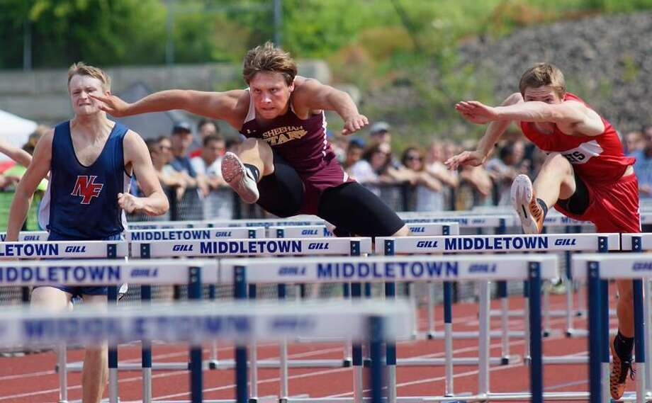 Middletown—Sheehan's Dan Baum wins the third 110-meter hurdle heat during the Class MM track meet at Middletown High School. Photo-Peter Casolino/Register pcasolino@newhavenregister.com