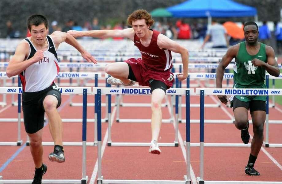 Middletown High School, Class L track meet. North Haven's John Spencer placed third in the hurdles. Mara Lavitt/New Haven Register mlavitt@newhavenregister.com5/28/13