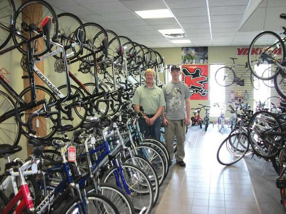 Photo by Lynn Fredricksen Joe Sayers and Chance Michaud own North Haven Bike where they outfit people of all ages with just the right set of wheels.