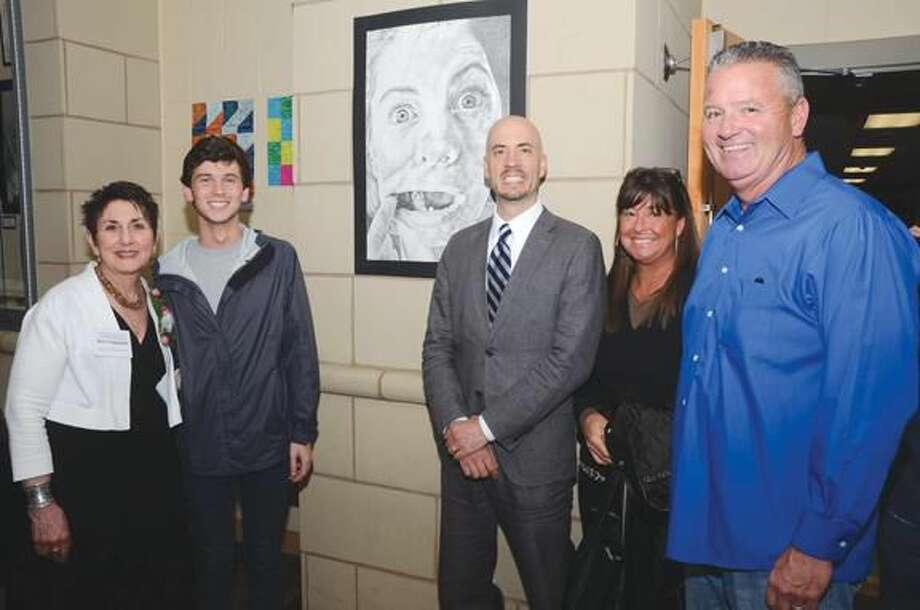 Submitted photo by Bill O'Brien North Haven Arts Coordinator Ann Cappetta, Aedan O'Brien, North Haven prinicpal Dr. Russell Dallai and Aedan's parents Francine and Jim O'Brien pictured with the winning piece.