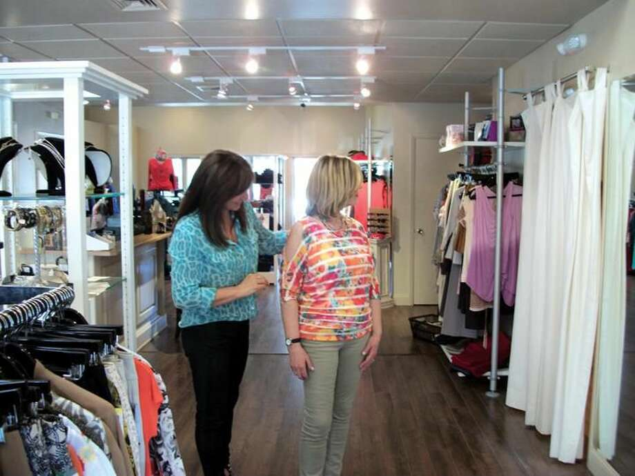 Photo by Lynn Fredricksen Mary Scasino helps customer Alice Murallo adjust a new blouse at LaModa on Whitney Avenue. Murallo, a long time customer, travels from Waterford to shop at LaModa because of the great customer service Scasino and her staff provide.