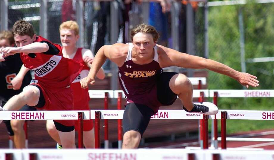 Wallingford—Sheehan's Dan Baum on his way to winning the second heat in the 100 hurdles. Photo-Peter Casolino/Register pcasolino@newhavenregister.com