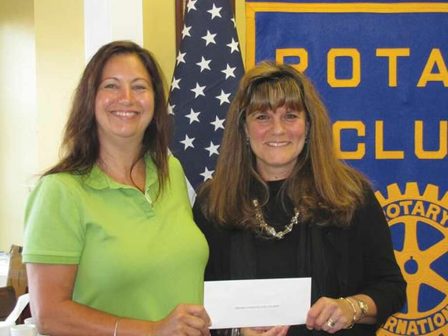 Submitted Photo courtesy of David Marchesseault & George Guertin Theresa Ranciato-Viele, left, presents a check to Claudia Giulietti. It was one of several checks for children's causes that the North Haven Rotary Club obtained through their partnership with Kids For Kids, Inc. in April.
