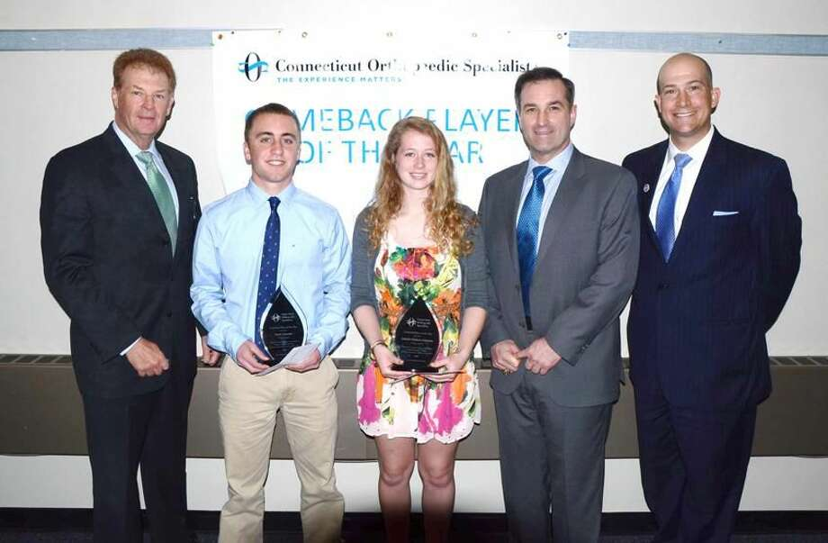 Photo by Bill O'Brien Guilford's Noah Criscuolo, second from left, and Lyman Hall's Isabelle Fishbein-Ouimette were selected as the Southern Connecticut Conference's Comeback Players of the Year. Also pictured, from left to right, are: Glenn Elia, CEO of Connecticut Orthopaedic Specialists, Dr. Richard Diana of Connecticut Orthopaedic Specialists, and SCC Commissioner Al Carbone.