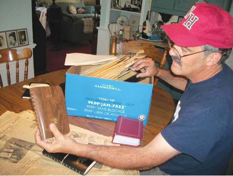 Submitted Photo Ted Stockmon, who rescued several boxes of memorabilia from a dumpster, is still discovering treasures in each one. He's amassed a collection of vintage newspapers, negatives, appointment books and complaint logs that date from the 1940s through the 1980s.