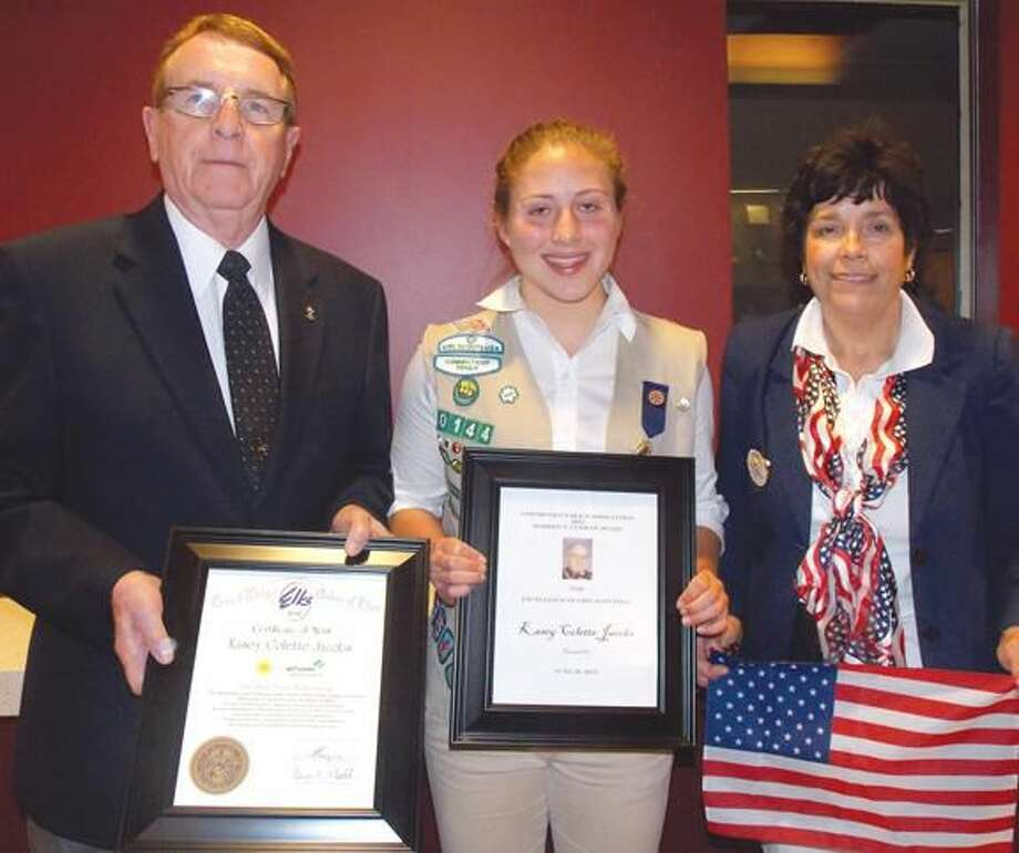 Submitted Photo Hamden Lodge President Alton Hudson presents award to local North Haven recipient Kasey Colette Jacobs, while Past President Karen Forsyth presents an American flag.