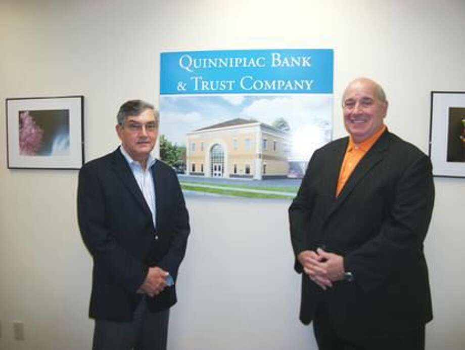 Photo by Lynn Fredricksen Richard R. Barredo (Left) and Mark A. Candido (right) stand by an artist's rendering of the new headquarters of their Quinnipiac Bank. Currently at 2600 Dixwell Avenue, the new headquarters at 2704 Dixwell Avenue will feature an ATM and a drive-up window. They expect the relocation to be complete within a month.
