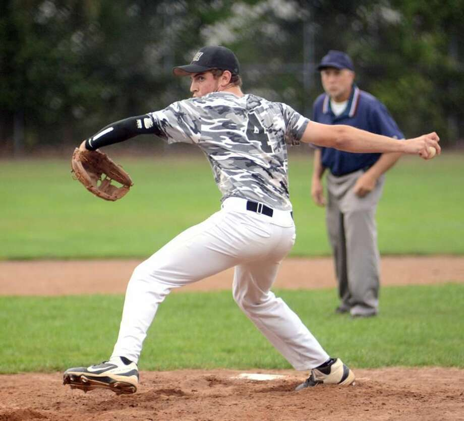 Photo by Dave Phillips North Haven's Ryan McLane delivers a pitch during Sunday's 7-1 victory over New Haven at Montowese Field.