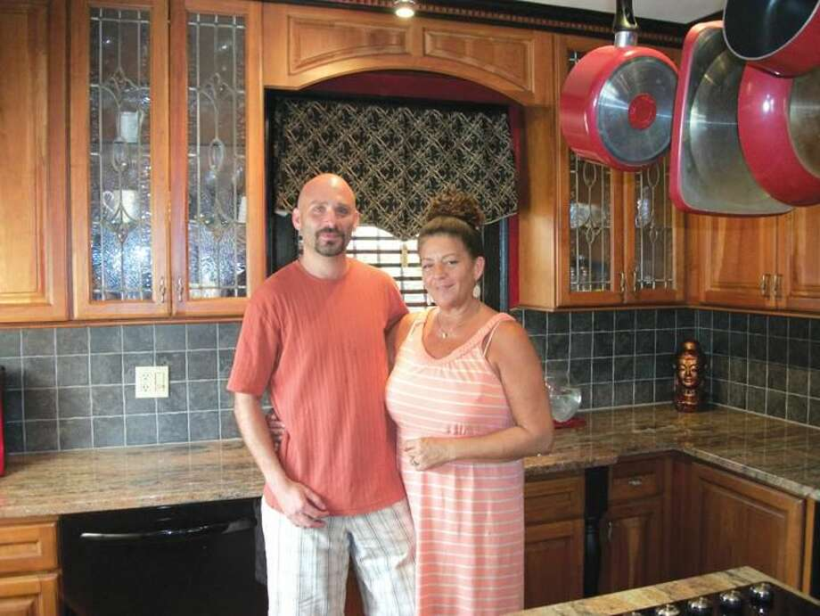 Photo by Lynn Fredricksen Chris and Lisa Harder stand in one of their display kitchens inside their business, Harder Kitchens and Baths at 333 Washington Ave. in North Haven. The couple provides full service kitchen and bath remodeling from design to completion. Reach them at 203-239-9816 or visit www.harderkitchensandbaths.com.