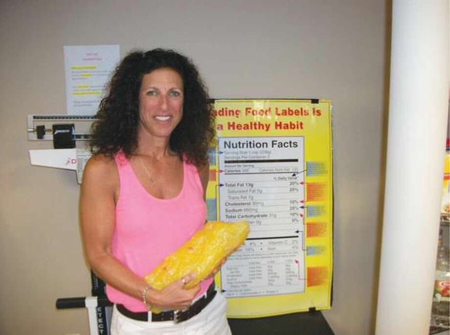 Photo by Lynn Fredricksen Joanne Hoffman, of Eats4Life, helps people improve their lives and overall health by teaching them to make healthy food choices, rather than dieting. She is holding a synthetic replica of 5 lbs. of body fat which she keeps in her office as a learning tool.