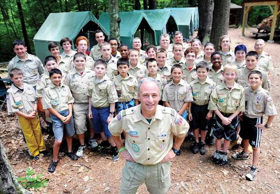 Arnold Gold Ñ RegisterScoutmaster Bill Earley (foreground center) is photographed with Boy Scout Troop 610 of Hamden at Camp Sequassen in New Hartford, Connecticut, on 7/5/2013.