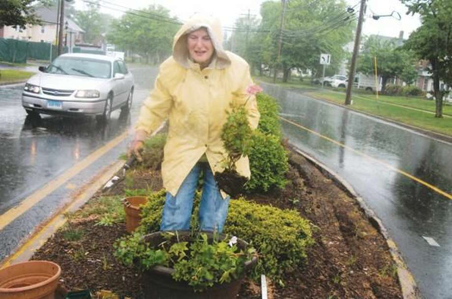 Submitted Photo North Haven Garden Club member Annette Bailey with plantings along Bailey Road.