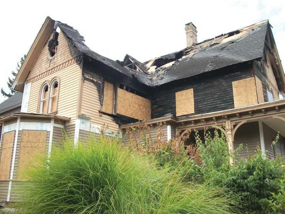 """Photo by Lynn Fredricksen The Merton Gillette House, 32 State Street (circa 1867), incurred some serious fire damage recently allegedly caused when a roofer was using a torch during a roof replacement project. This house has been featured on the North Haven Historical Society's annual Trolley Tour and is said to be the """"finest example of High Victorian domestic architecture"""" in town, according to information provided by the Historical Society."""