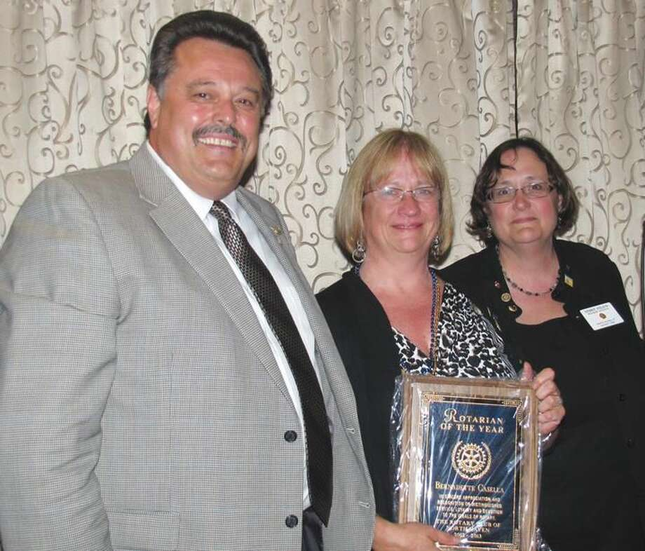 Submitted Photo by David Marchesseault Rotarian of the Year Bernadette Casella posed with her husband Gaetano and the current North Haven Rotary President, Debbie Volain.