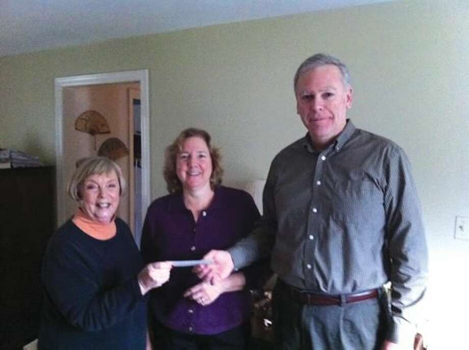 Submitted Photo Shown delivering the check to Friends of Brooksvale Vice President Gail Traester (center) and Treasurer Jim Traester (right) is Hamden Rotarian Betsy Gorman (left).