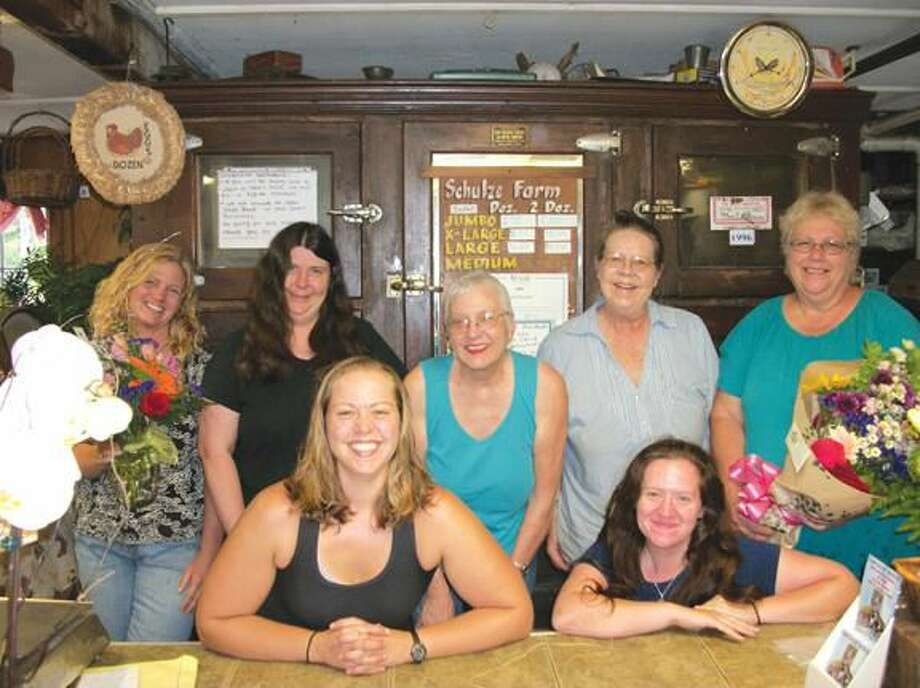 Photo by Lynn Fredricksen Flowers From the Farm, 1035 Sherman Ave., is a busy place where everyone works hard together. Front row, left to right: Michelle Bojarski and Darlene Ravid; standing, left to right: Kate Ambruso, Karen Wawock, Lauren Bojarski and Sharon Sivek. Missing from photo is driver Elizabeth Day who was on the road delivering flowers when the photo was taken.