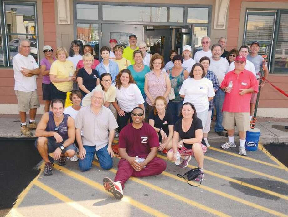 Submitted Photo Pearce Real Estate's employees and agents gather for its 12th annual Day of Caring at Columbus House recently.