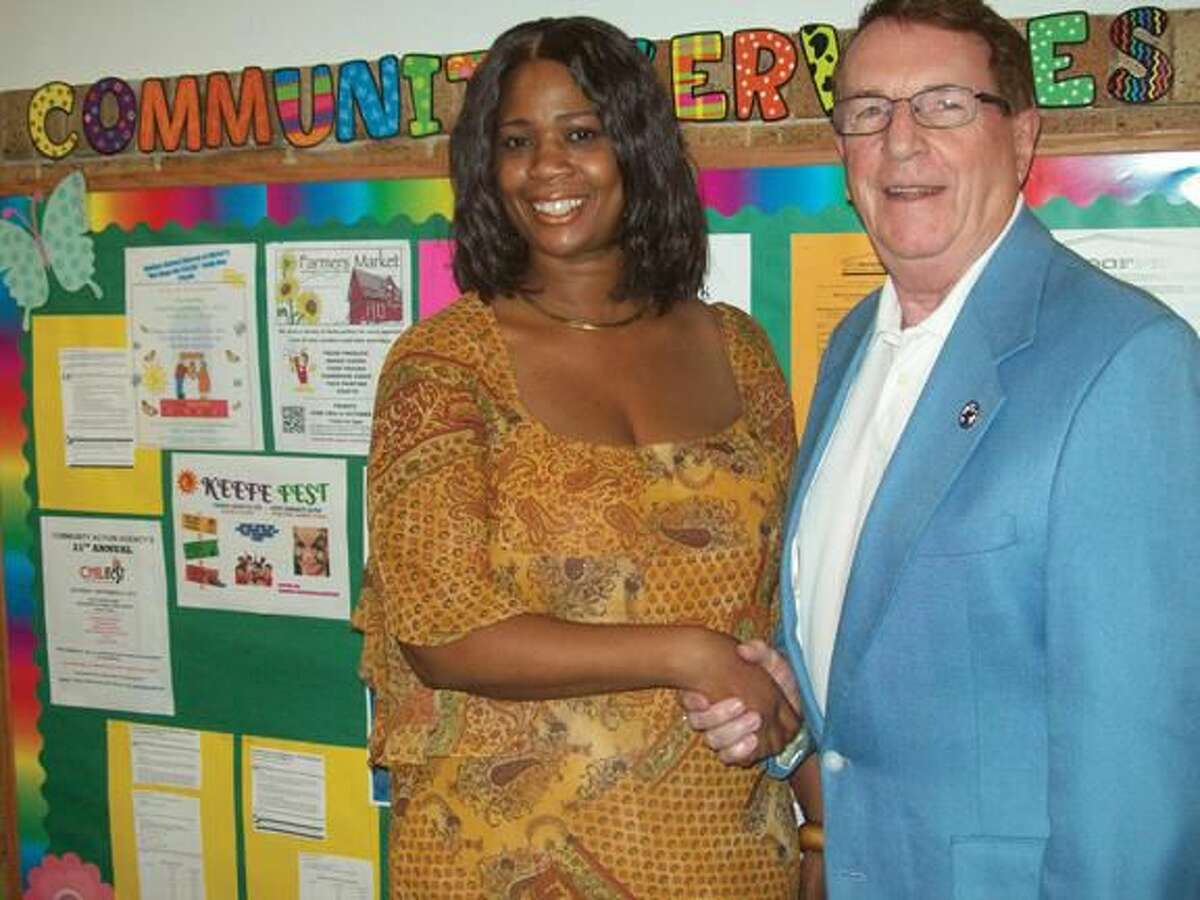 Submitted Photo Hamden Lodge President Alton Hudson presents a donation to Hamden Community Services Director Darlene Butler.