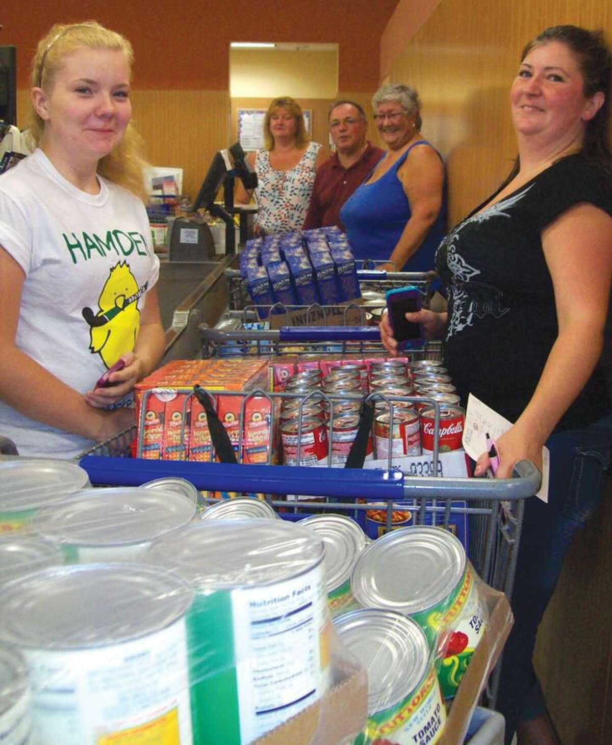 Submitted Photo Pictured are Lodge Members Andrew Caporossi, Jen Caputo, Tammy Shea and Kathy Kelsey and local student Jessica Kelsey purchasing groceries for local food banks.