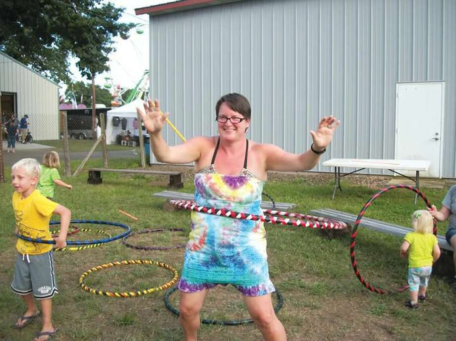 Photos by Lynn Fredricksen Laura Feist-Roche, of West Haven, visited the North Haven Fair for the first time and enjoyed trying her hand at the hula hoop. Local Boy Scouts from Troop 810 provided the hula hoops and several other games for people to play.