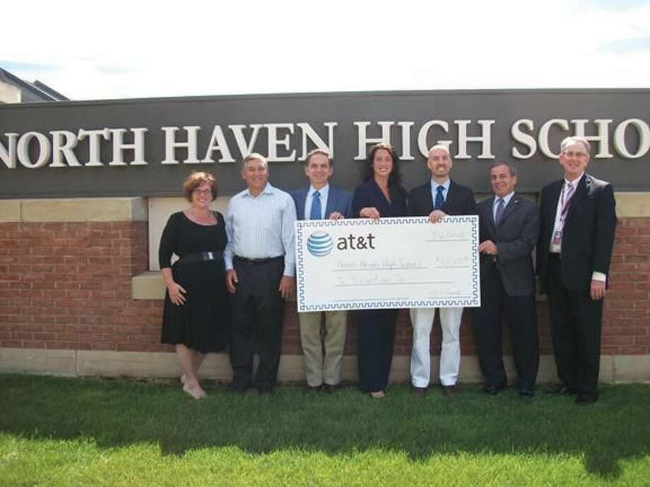 Photo by Lynn Fredricksen Pictured left to right are Anita Anderson, Chairman of the Board of Education; Senator Len Fasano; State Rep. Dave Yaccarino; Kelly Wade Bettuchi, Director of External Affairs for AT&T; High School Principal Russ Dallai; First Selectman Mike Freda; and Superintendent of Schools Robert Cronin.