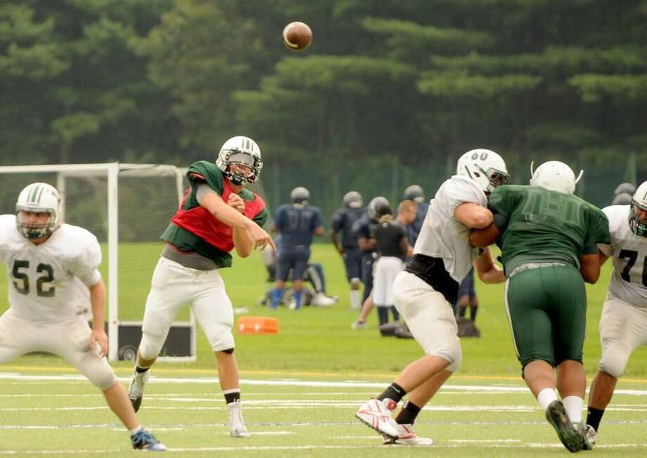 (Peter Hvizdak — Register)Hamden Hall quarterback T.J. Linta during scrimmage at Hamden Hall Saturday August 31, 2013.
