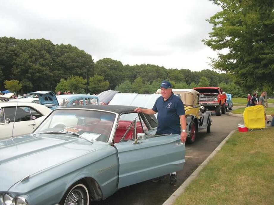 Photos by Lynn Fredricksen Police Lt. Mark Genovese showed his 1964 Ford Thunderbird at the Annual Police Benevolent Association Labor Day Weekend car show at North Haven High School.
