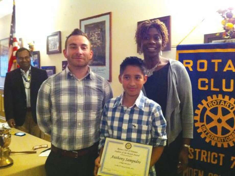 Submitted Photo Left to right are Rotary Club president Mohammad Elahee, teacher Jeff Bloomfield, honoree Anthony Sampedro and principal Karen Butler.