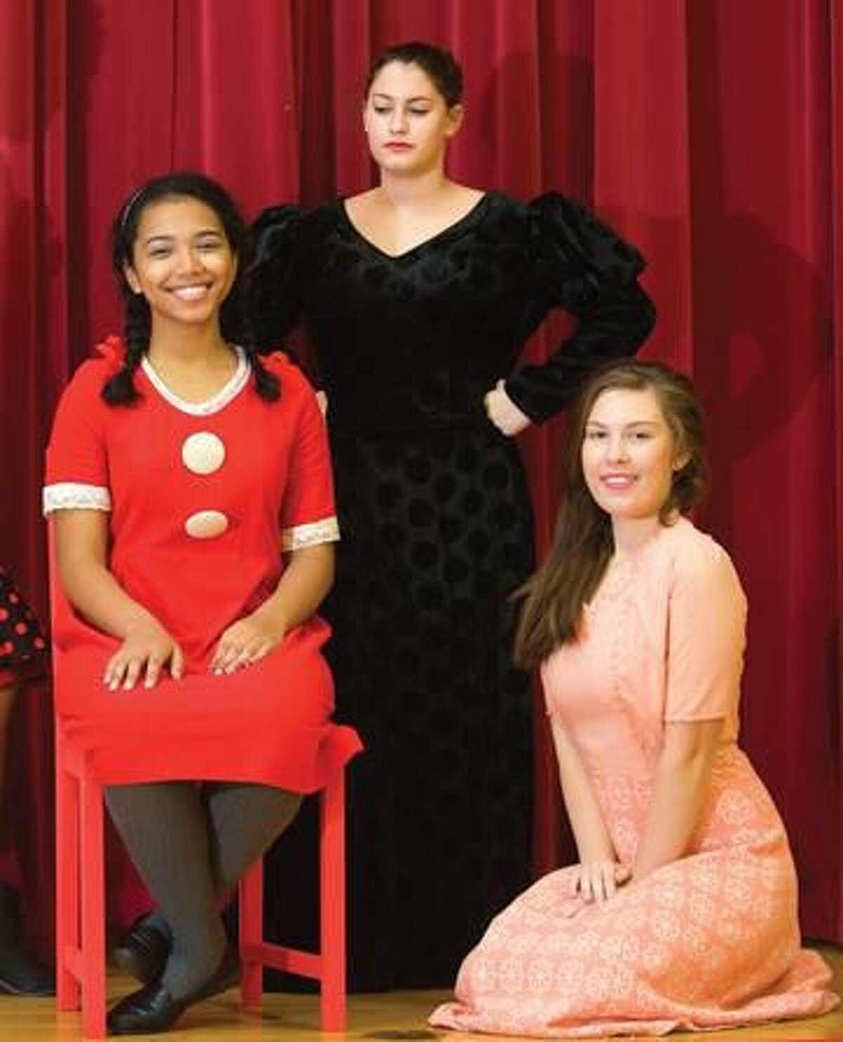 Submitted Photo by Cronin Photography, Cheryl Cronin Starring in the musical Annie at the Shubert in November are Sacred Heart senior Kanita Mote as Annie, junior Kayla Hansen as Grace, and senior Rachel Porzio as Miss Hannigan (back) at the Shubert New Haven.