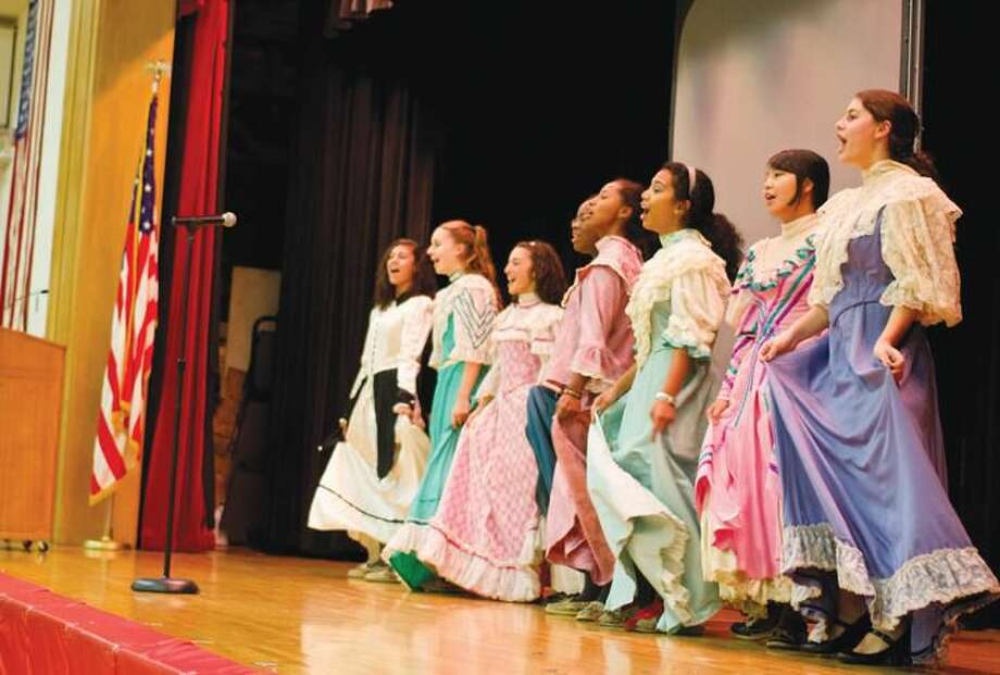 Submitted Photo Academy students perform at the welcoming assembly for Apostle Leadership from Around the World.