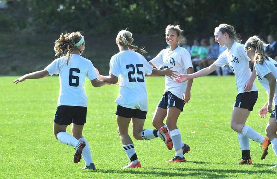 (Peter Casolino — New Haven Register) Lauralton Hall celebrates a goal by Helena Sorenson (#25) during the first half of a recent game. 09/26/13