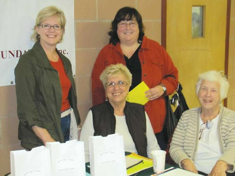Submitted Photo Representatives of the Education Foundation provided luminaries to the waves of hungry ticket holders at the Rotary Pancake Breakfast on November 10th. (L-R) Standing: Joan Genest and Mary Lou Stamp; Seated: Patricia Buonpane and Alicia Clapp.