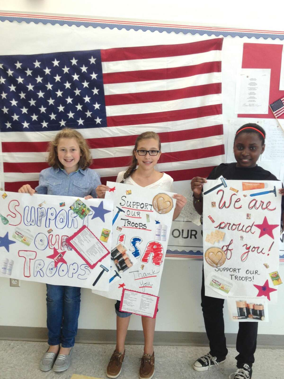 Submitted Photo Hamden Middle School students, left to right: Caitlin Murphy, Aleah Grindell, and Brianna Morris, display their posters in support troops deployed in Afghanistan.