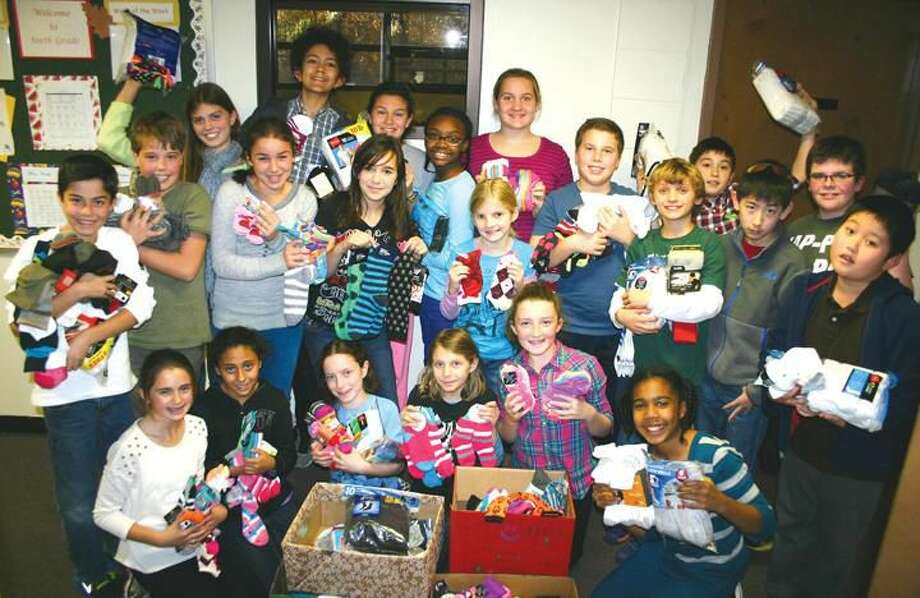 Submitted Photo Hamden Hall sixth-graders display the 462 pairs of socks collected by Lower School students.