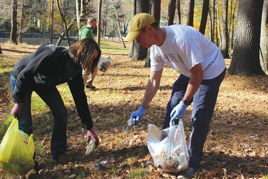 Submitted Photo Quinnipiac University School of Law students Rebecca Schlenker and Michael Tone of the Environmental Law Society picked up 30 pounds of trash Nov. 3 at Sleeping Giant State Park.