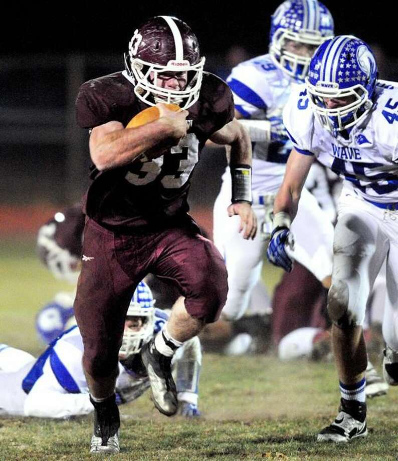 (Arnold Gold Ñ New Haven Register) Ethan Suraci of North Haven runs against Darien in the first half on 11/15/2013.