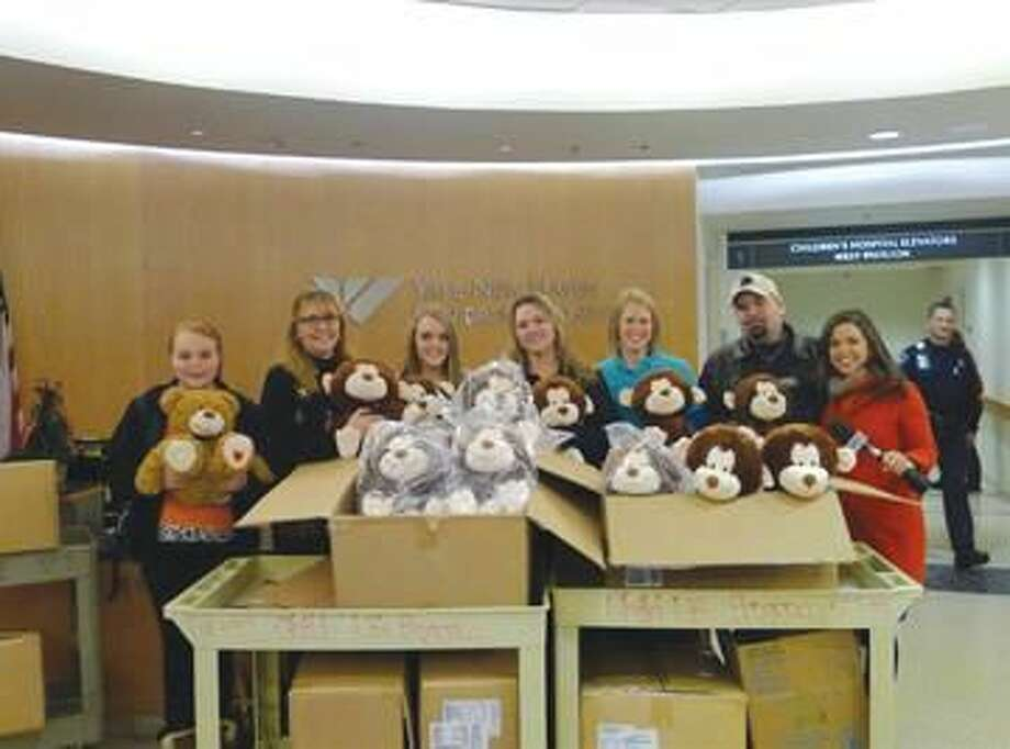 Submitted Photo courtesy Yale New Haven Hospital The Jacques family and friends deliver 70 stuffed monkeys to Yale New Haven Children's Hospital. Pictured left to right: Julia Brock, Cynthia Brock, Mandy Brock, Melissa Jacques, Erica Bailey (Yale Child Life), Alphonse Jacques, and Stephanie Siomni (WTNH).