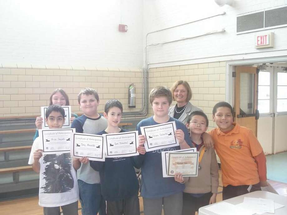 Submitted Photo Pictured back row, left to right: Genevieve Richardson, Anthony Ansaldo, and Principal Mrs. Peters-Durrigan. Front row, left to right: Arya Sayadi, Sam Preschel, Carson Tebbetts, Hansen Wu, and Kyle James.