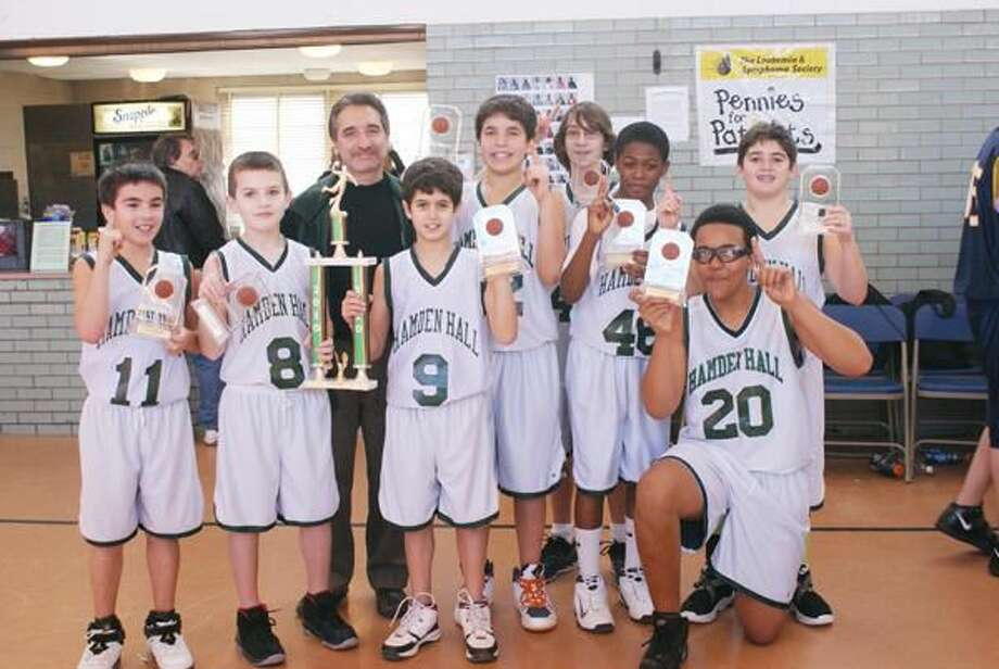 Hamden Hall sixth grade boys basketball team celebrate their recent win. Pictured from left to right are: Jaedin Falcone, Michael DiMartino, Coach Andy Aquarulo, Marco Fontana, Ronny LoRicco, Micael DeFelice, CJ Holmes, Kevin Johns, Jake Teplitzky, missing from photo, Brandon Massey and Coach Tim Fusco.