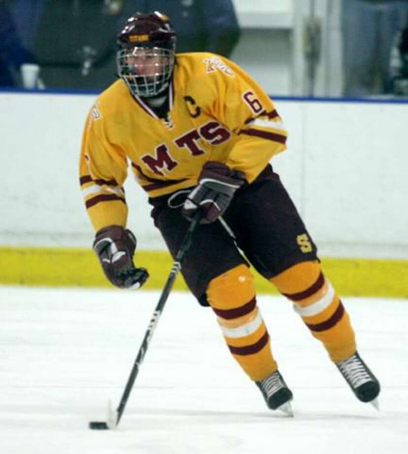 Sheehan captain George Wooster skates with the puck in a game played earlier this season. (Photo by Russ McCreven)
