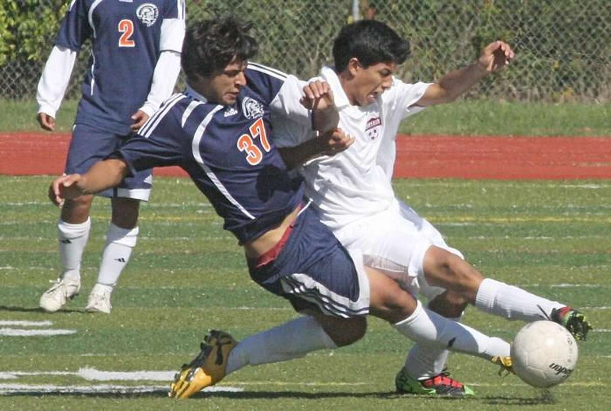Photo by Russ McCreven The Sheehan boys' soccer team took the first game of the town rivalry series with a 4-1 victory over Lyman Hall Saturday morning at Riccitelli Field.