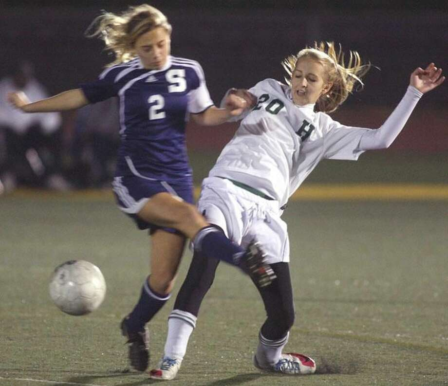 Photo by Russ McCreven Hamden's Allie DiCrosta tangles with Staples' Alexandra Crofts for control of the ball.