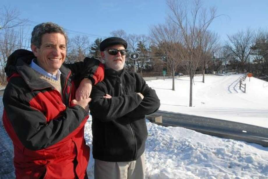Photo by Peter Hvizdak David R. Schafer, chairman of the Hamden Farmington Canal Commission, left, and Assistant Town Planner Dan Kops, right, near the planned tunnel underneath the Farmington Canal linear trail on Skiff Street in Hamden 1/17/10. Putting a tunnel underneath the trail has been in the planning stages for approx. three years.